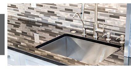 quartz countertops and tile backplash